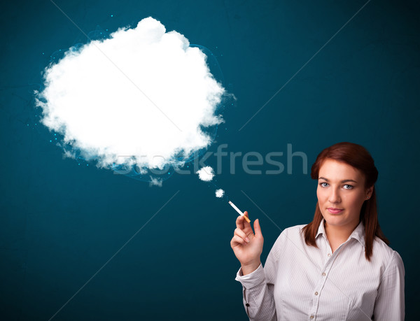 Mulher jovem fumador insalubre cigarro denso fumar Foto stock © ra2studio