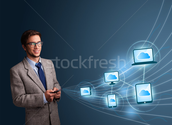 Handsome man typing on smartphone with cloud computing Stock photo © ra2studio