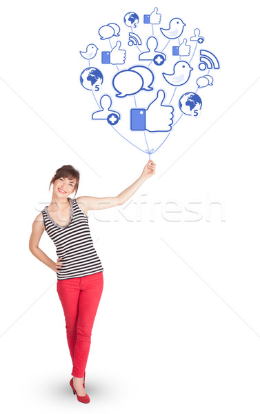 Happy lady holding social icon balloon Stock photo © ra2studio