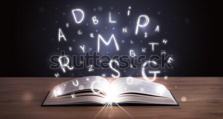 Nyitott könyv izzó levelek repülés ki fa Stock fotó © ra2studio