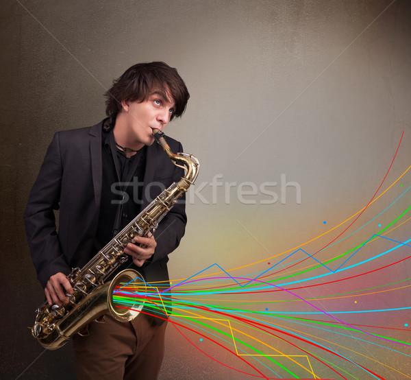 привлекательный музыканта играет саксофон красочный аннотация Сток-фото © ra2studio