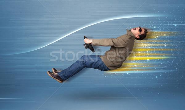 Jonge man rijden denkbeeldig snel auto wazig Stockfoto © ra2studio