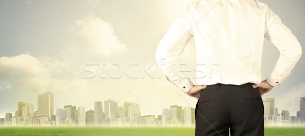 Businessman with city view Stock photo © ra2studio