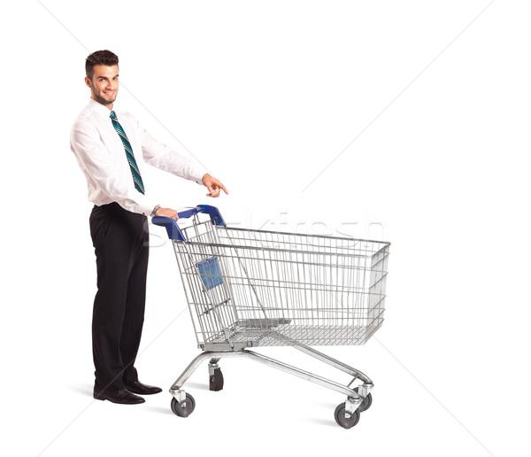 Zakenman winkelwagen voortvarend geïsoleerd winkelen pak Stockfoto © ra2studio