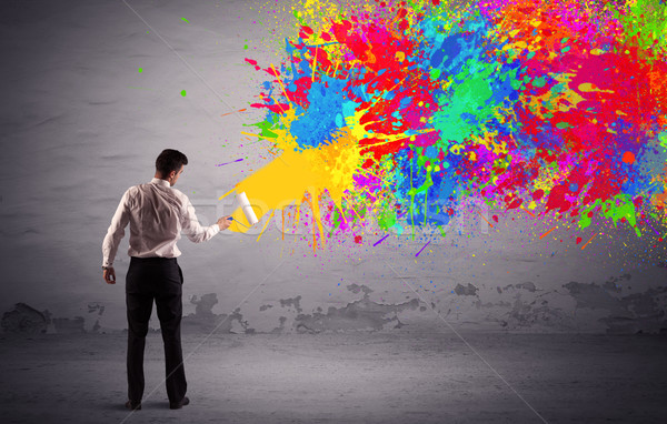 Sales person painting colorful splatter Stock photo © ra2studio