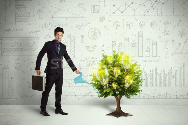 Business man pouring water on lightbulb growing tree Stock photo © ra2studio