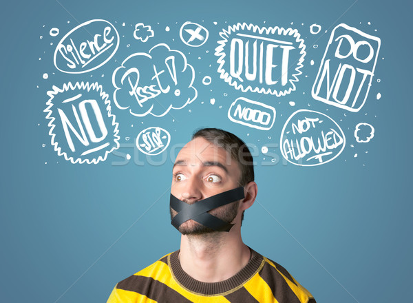 Young man with glued mouth and thought clouds Stock photo © ra2studio