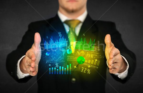 Businessman holding diagram cloud Stock photo © ra2studio