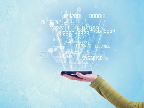 Mano telefono digitale numeri bianco Foto d'archivio © ra2studio
