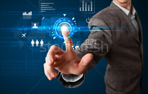 Handsome businessman touching future web technology buttons and  Stock photo © ra2studio