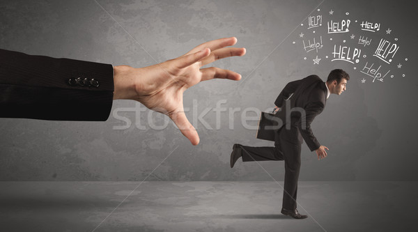 Business person running away from big hand  Stock photo © ra2studio