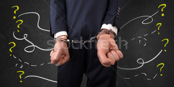 Close prisoner hand with questions around Stock photo © ra2studio