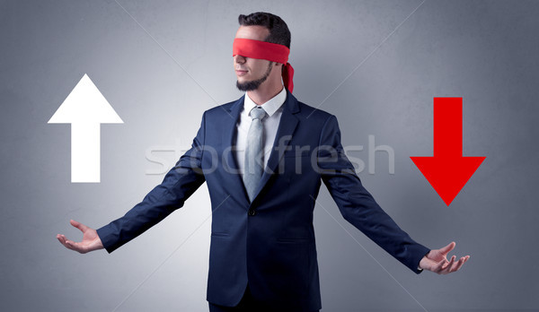 Covered eye businessman choosing direction Stock photo © ra2studio