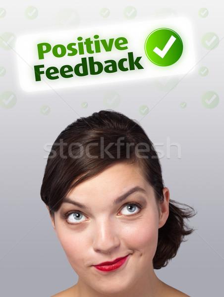 Jovem olhando positivo negativo sinais cabeça Foto stock © ra2studio