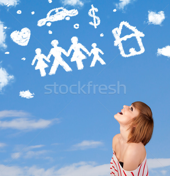 Stock photo: Young girl daydreaming with family and household clouds
