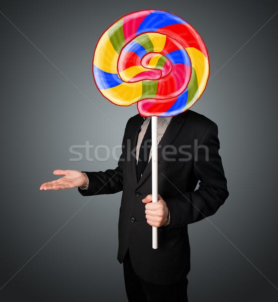 Empresario pirulí colorido a rayas cabeza Foto stock © ra2studio