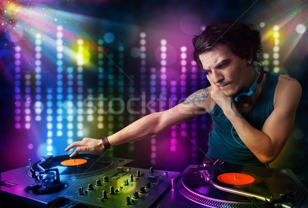 Jugando disco luz mostrar jóvenes fiesta Foto stock © ra2studio