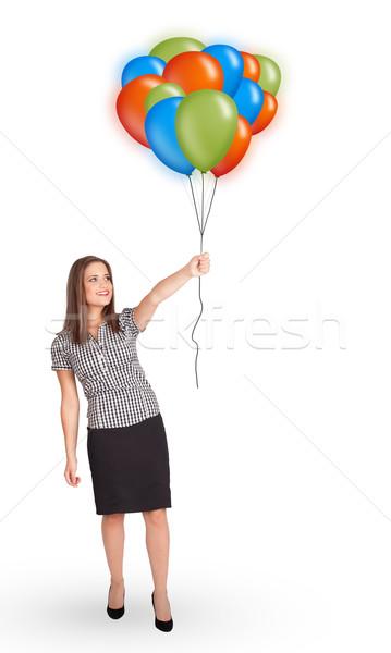 Young woman holding colorful balloons Stock photo © ra2studio