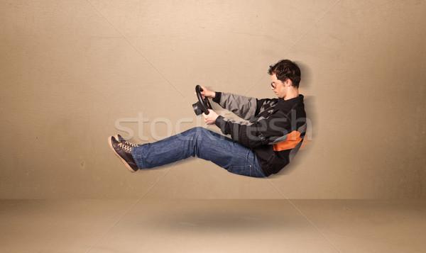 Stockfoto: Gelukkig · grappig · man · rijden · vliegen · auto