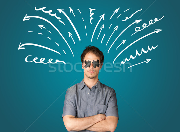 Young man with glued eye and lines, arrows Stock photo © ra2studio