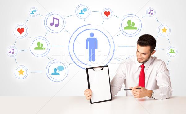 üzletember közösségi média kapcsolat üzletember ül fehér Stock fotó © ra2studio