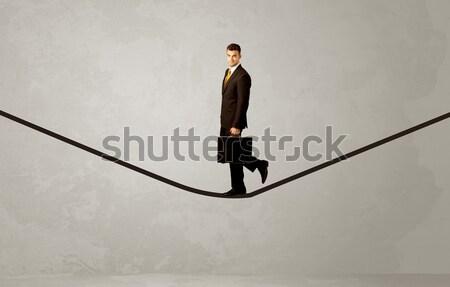 продавцом ходьбе веревку серый пространстве бизнесмен Сток-фото © ra2studio