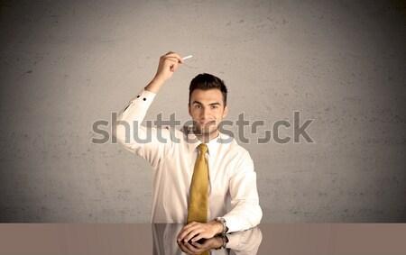 Elegant person drawing in empty space Stock photo © ra2studio