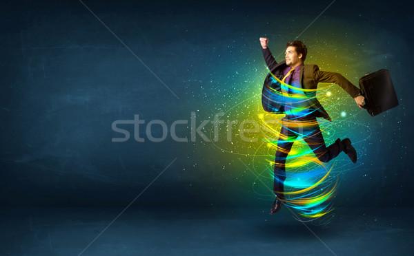 Izgatott üzletember ugrik energia színes vonalak Stock fotó © ra2studio