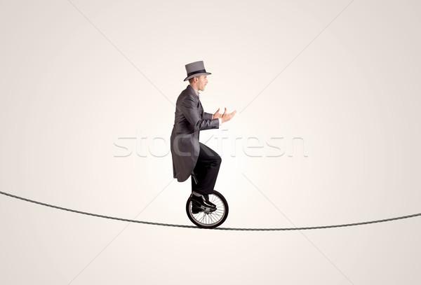 Extrém üzletember lovaglás egykerekű bicikli kötél üzlet Stock fotó © ra2studio