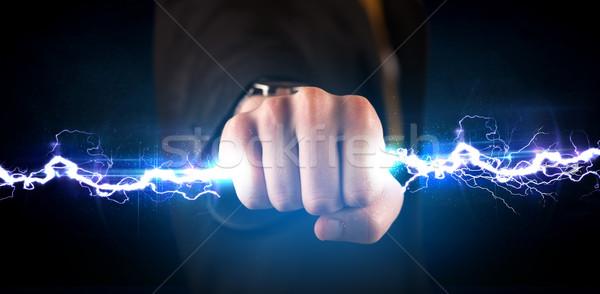 Człowiek biznesu elektrycznej świetle ręce Zdjęcia stock © ra2studio