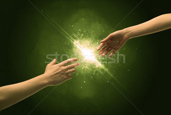 Tocante brasão iluminação faísca ponta do dedo dois Foto stock © ra2studio