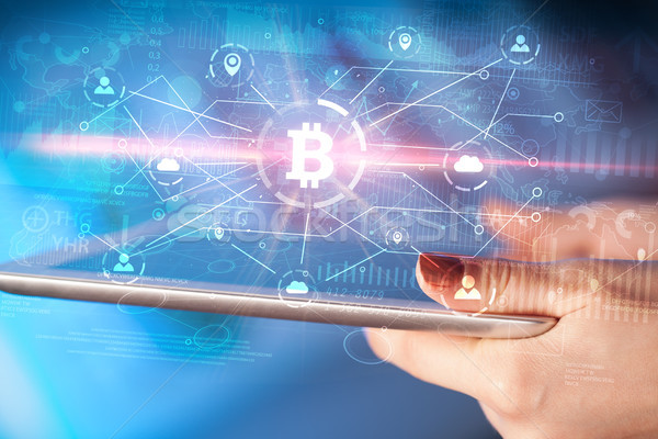 Hand using tablet with bitcoin link network and online concept Stock photo © ra2studio