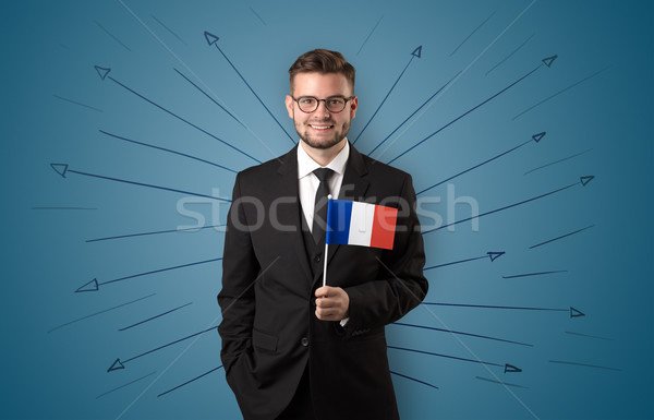 Man standing with flag and destination concept Stock photo © ra2studio