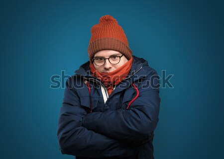 Handsome boy freezing in warm clothing Stock photo © ra2studio