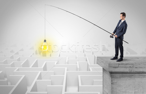 Stock photo: Businessman fishing new idea from a maze concept