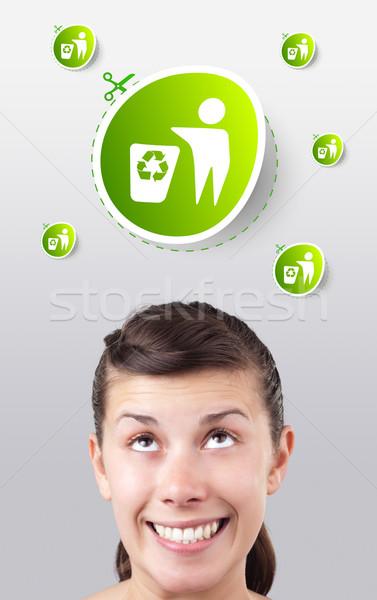 Zdjęcia stock: Młoda · dziewczyna · patrząc · zielone · eco · podpisania · głowie