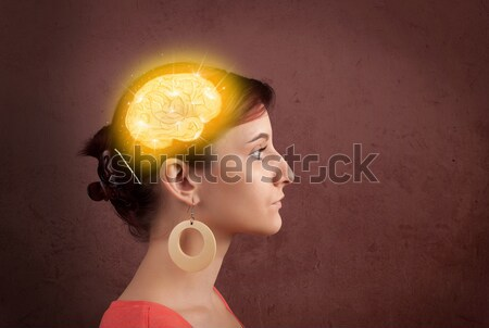 Young girl thinking with glowing brain illustration Stock photo © ra2studio