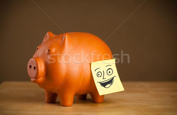 Nota rosto sorridente piggy bank papel cara Foto stock © ra2studio