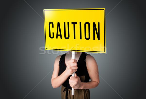 Precaución signo jóvenes dama Foto stock © ra2studio