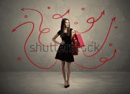 Stylish woman shopping and red arrows Stock photo © ra2studio