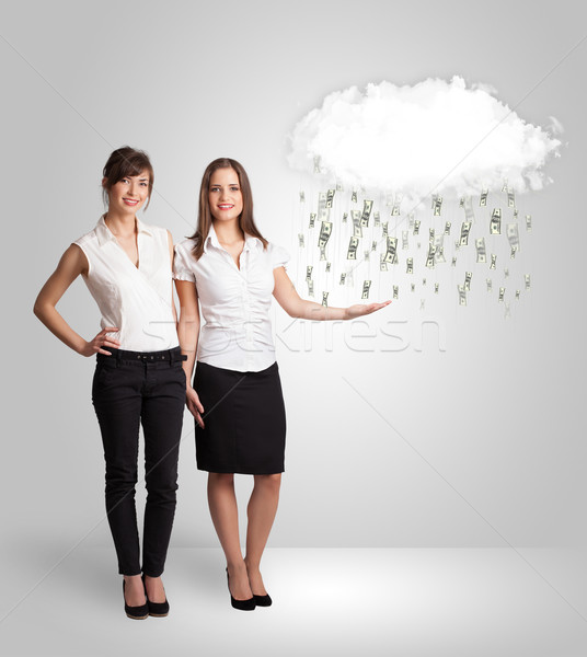 Woman with cloud and money rain concept Stock photo © ra2studio