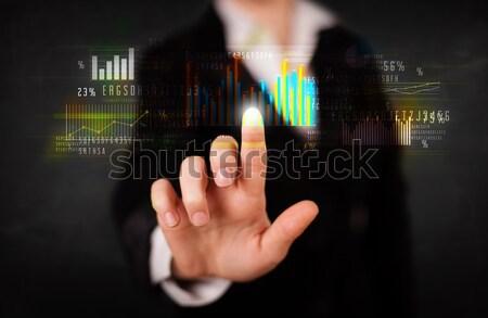 Jovem empresário tocante colorido gráficos diagramas Foto stock © ra2studio