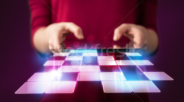 Close up of hand holding tablet with cyber application Stock photo © ra2studio
