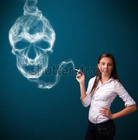 Jeune femme fumer dangereux cigarette toxique crâne Photo stock © ra2studio