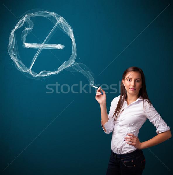 Jóvenes dama fumar insalubre cigarrillo Foto stock © ra2studio