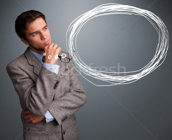 Good-looking young man thinking about speech or thought bubble Stock photo © ra2studio
