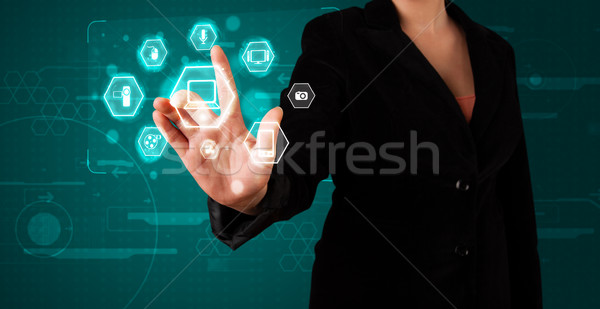 Stock photo: Girl pressing virtual media type of buttons