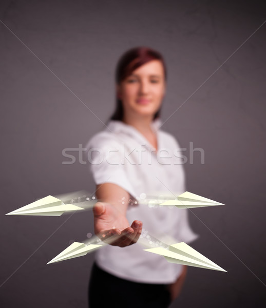 Beautiful lady throwing origami airplanes Stock photo © ra2studio