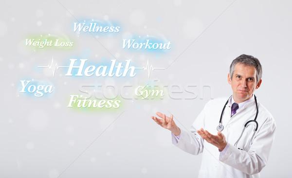 клинический врач указывая здоровья фитнес коллекция Сток-фото © ra2studio