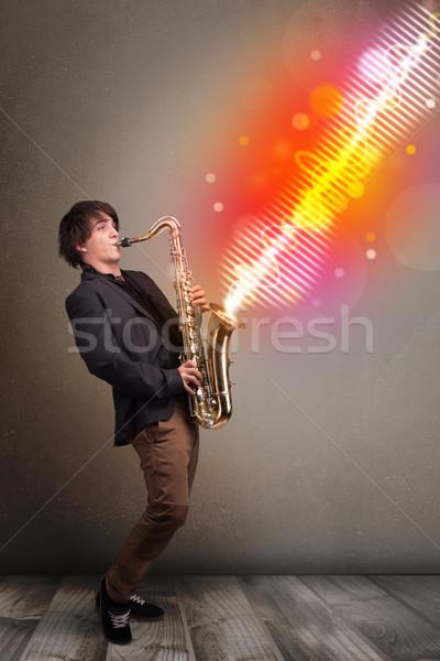 Jonge man spelen saxofoon kleurrijk geluid golven Stockfoto © ra2studio